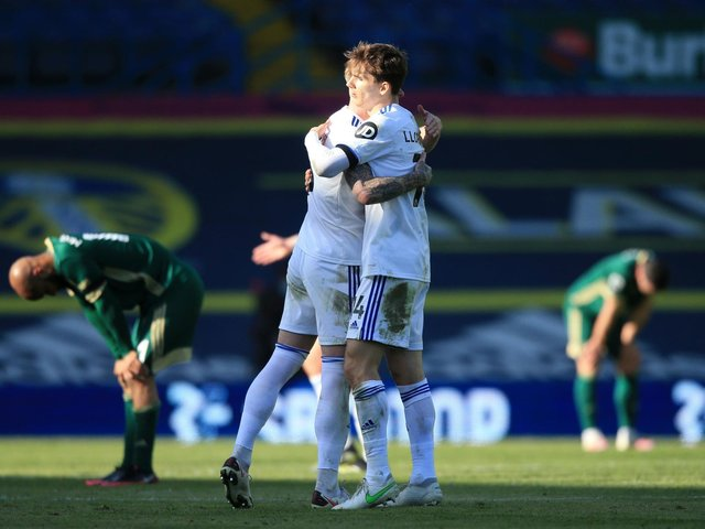 VICTORY HUG: Leeds United centre-back partners Liam Cooper, left, and Diego Llorente, right, embrace after Saturday's 2-1 victory against Sheffield United at Elland Road. Picture by Lindsey Parnaby/PA Wire.
