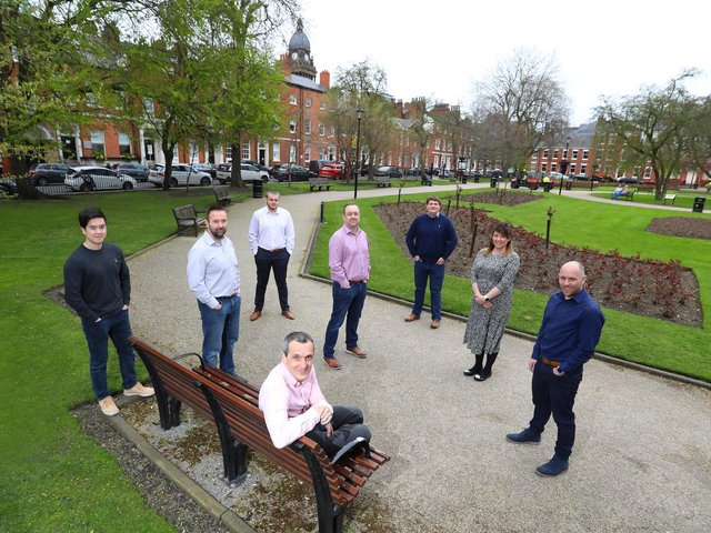 Andrew Fairburn (sitting on bench) and some of the RWO team who have moved to larger offices to accommodate growth and demand for services