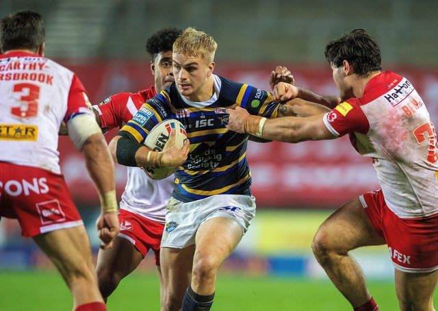 TOUGH TEST: Leeds Rhinos' Alex Sutcliffe is tackled by James Bentley in the league match between the two teams last October.  Picture: Bruce Rollinson.