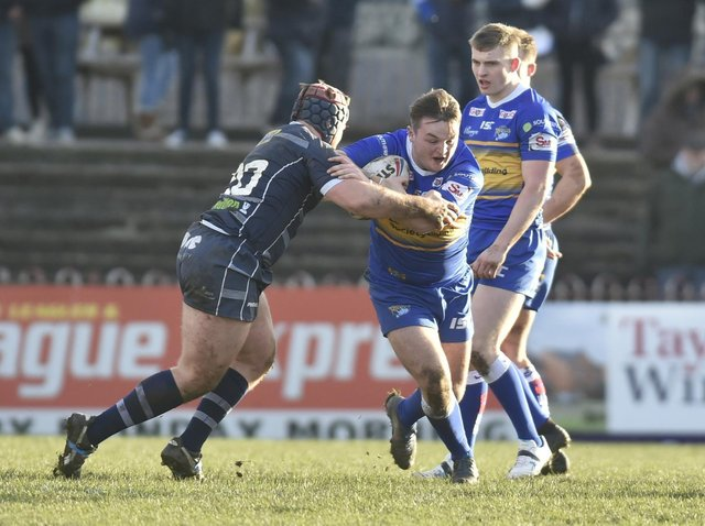 Loui McConnell in possession for Rhinos during a pre-season clash with Rovers two years ago. Picture by Steve Riding.
