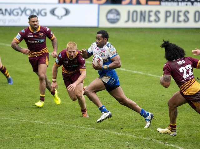 King Vuniyayawa, pictured in pre-season acrtion against Huddersfield, is in contention for his Rhinos debut. Picture by Tony Johnson.