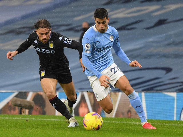 LICENCE: For Manchester City's Joao Cancelo, right, to drift inside as part of a case of 'inverting' the full back. Photo by Shaun Botterill/Getty Images.