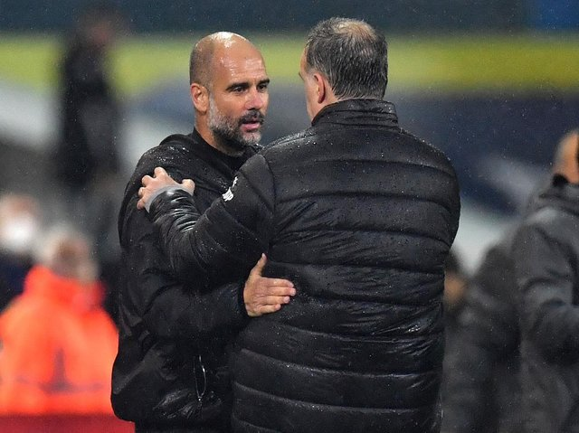 Manchester City boss Pep Guardiola greets Leeds United's Marcelo Bielsa at Elland Road. Pic: Getty