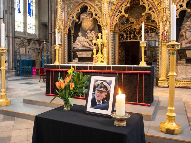 A photograph of the Duke of Edinburgh is displayed alongside the nave at Westminster Abbey, London, which has been dressed in black to mark his death (Photo: Dominic Lipinski/PA Wire)