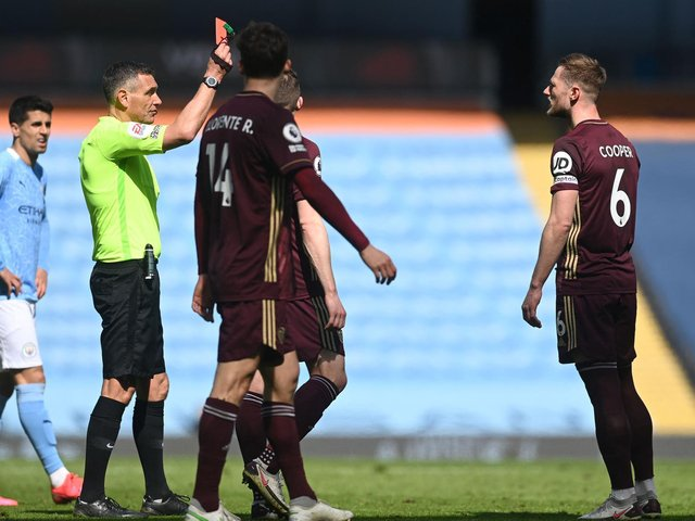 LAST LAUGH: For Leeds United through Saturday's 2-1 triumph at Manchester City despite Whites captain Liam Cooper, right, being shown a straight red card. Photo by Michael Regan/Getty Images.