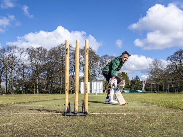 Adel Cricket Club junior Billy Hodges runs between the stumps taking on the challenge of getting 12,472 runs in three days