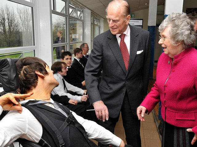 Prince Philip pictured in 2011 during a visit to the Prince Philip PHAB Club, meeting up with Nathan Pride, 19, accompanied by Ann Hart, then President of PHAB Club. Picture: Graham Lindley