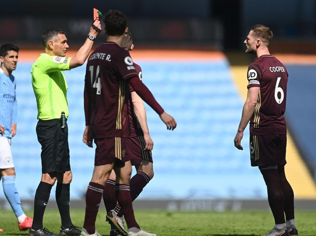 Leeds United captain Liam Cooper is sent off after a VAR review at Manchester City. Pic: Getty
