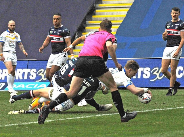Brad Dwyer scores in Rhinos' Super League round one win over Wakefield. Picture by Bruce Rollinson.