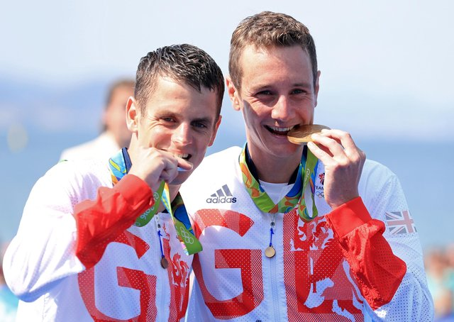 Great Britain's Alistair, right, and Jonny Brownlee with their gold and silver medals at the Rio Olympics. Picture: PA