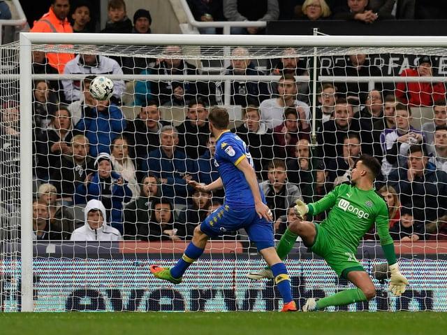 Leeds United striker Chris Wood scores against Newcastle United. Pic: Getty