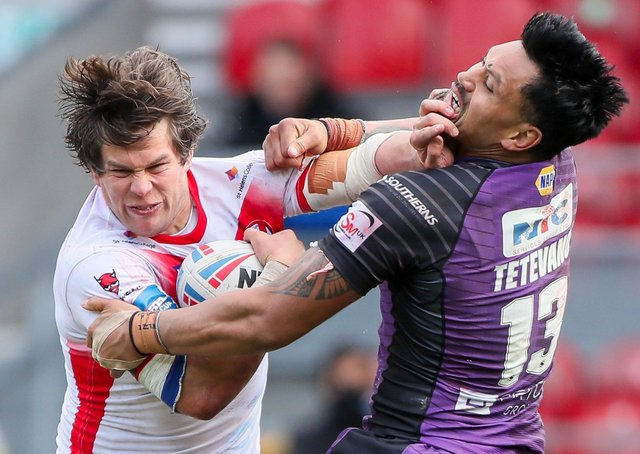 NO WAY THROUGH: St Helens' Louie McCarthy-Scarsbrook is tackled by Leeds' Zane Tetevano. Picture: Alex Whitehead/SWpix.com.