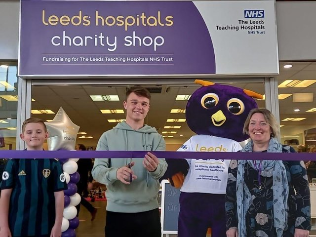 Left to right: Rhys Pearson, Jamie Shackleton, Ernie, Leeds Hospitals Charity mascot and Thadra Bryant, retail manager, Crossgates Charity shop.