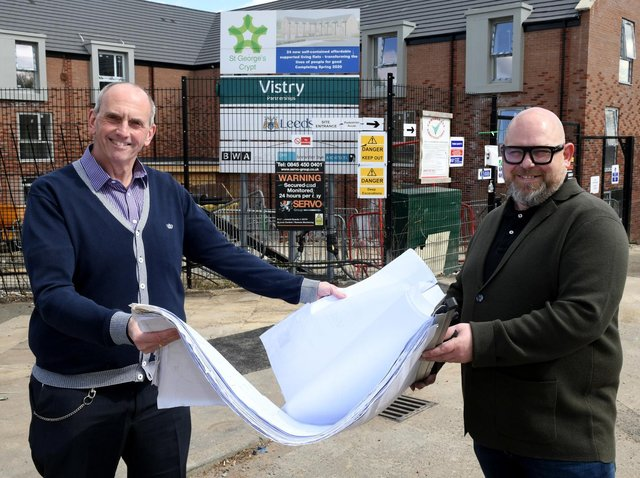 Chris Fields (left),  chief executive at St Georges Crypt, looking at the plans for the flats at Hedley Chase in New Wortley with Nathan Wilkinson for Brewster Bye Architects . Photo: Gary Longbottom