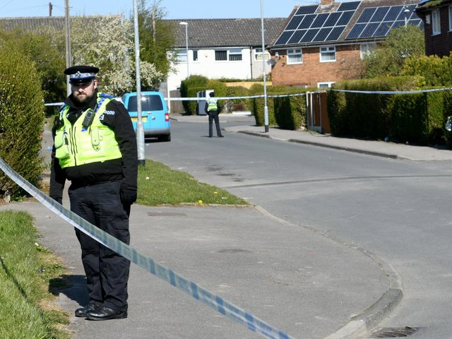 Police guard a cordon in Stanks Parade, Swarcliffe (photo: Gary Longbottom).
