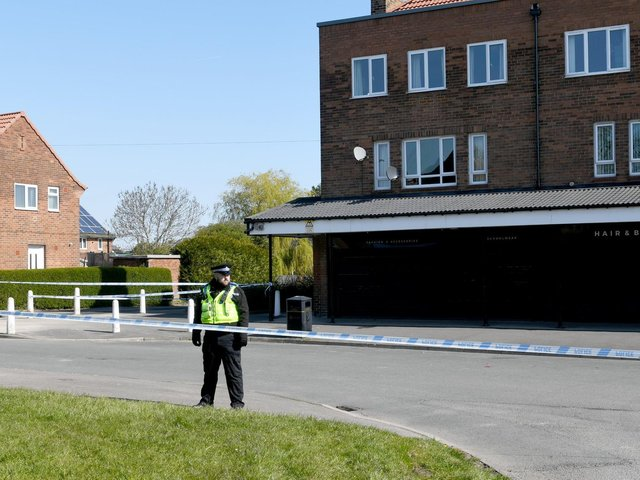Police guard a cordon in Stanks Parade, Swarcliffe, after the attack