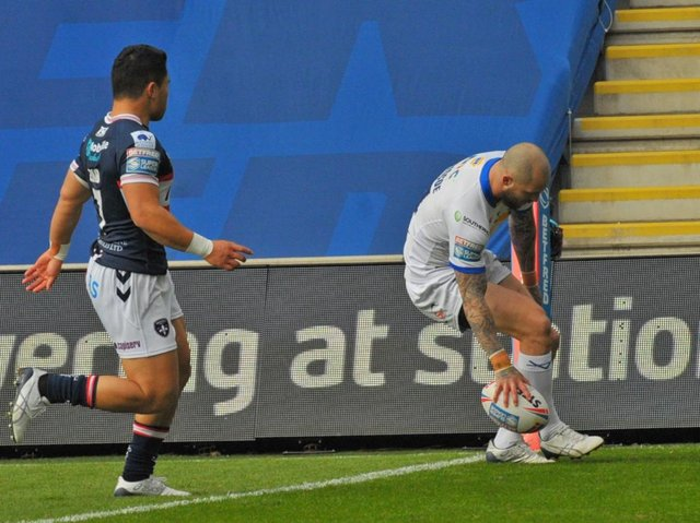 Luke Briscoe scores Rhinos' first try of the season, against Wakefield last month. Picture by Steve Riding.