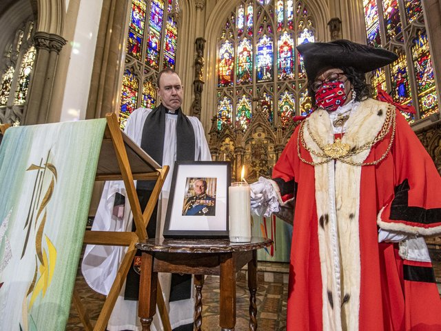Rev Sam Corley, Rector of Leeds Minster watches The Lord Mayor of Leeds Eileen Taylor light a candle. Picture Tony Johnson