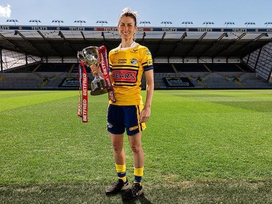 Rhinos captain Courtney Winfield-Hill with the Betfred Women's Super League trophy. Picture by Alex Whitehead/SWpix.com.