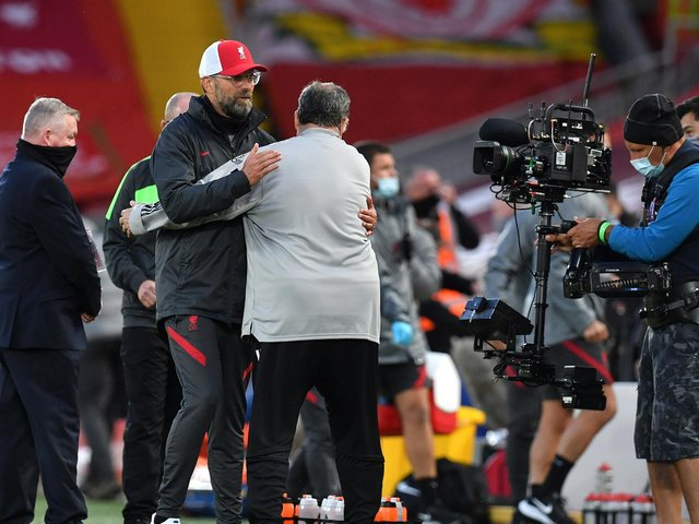 Liverpool boss Jurgen Klopp greets Leeds United head coach at Anfield. Pic: Getty