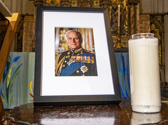 A photo and candle tribute in Leeds Minster following the death of the Duke of Edinburgh.