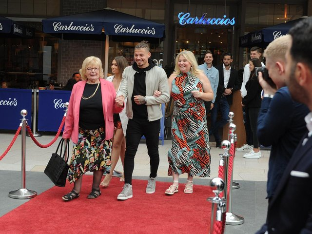 KEY INFLUENCE: Leeds United midfielder Kalvin Phillips, centre, with his much missed late grandmother Val Crosby or 'Granny Val', left, at the Take Us Home premiere in Leeds back in August 2019. Photo by Tony Johnson.