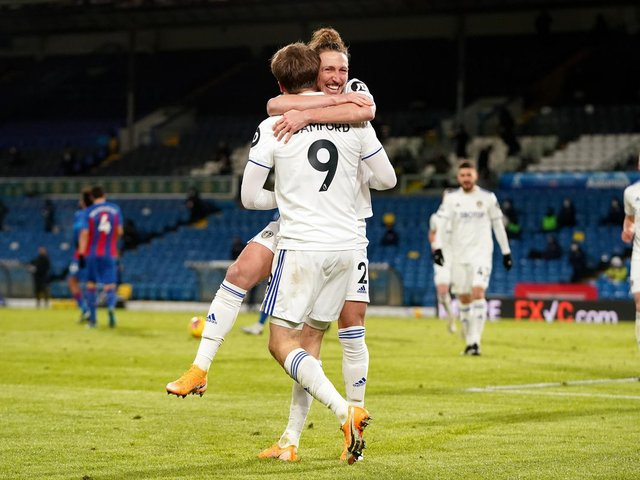 BACKING: For Leeds United no 9 Patrick Bamford from team mate Luke Ayling, pictured as the duo celebrate Bamford's strike in February's 2-0 victory against Crystal Palace. Photo by Jon Super - Pool/Getty Images.