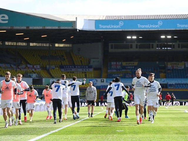 TRIBUTE: Marcelo Bielsa's Whites warm up prior to the home clash against Sheffield United earlier this month and pay their respects to club legend Peter Lorimer. Photo by LAURENCE GRIFFITHS/POOL/AFP via Getty Images.