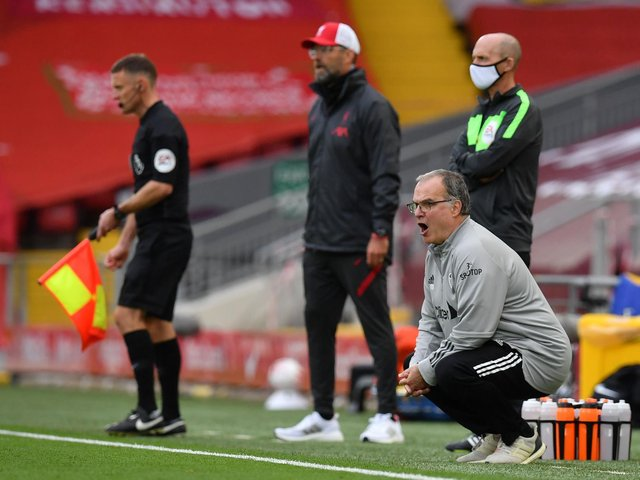 REMATCH: Between Leeds United head coach Marcelo Bielsa, right, and Liverpool boss Jurgen Klopp, centre, pictured during September's 4-3 epic at Anfield. Photo by PAUL ELLIS/POOL/AFP via Getty Images.