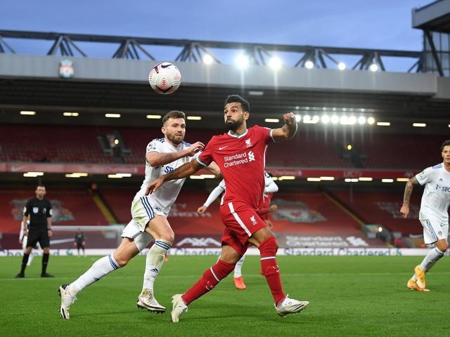 KEY PAIR: Liverpool striker Mo Salah, right, and thriving Leeds United midfielder Stuart Dallas, left, pictured during September's seven-goal thriller at Anfield. Photo by Shaun Botterill/Getty Images.