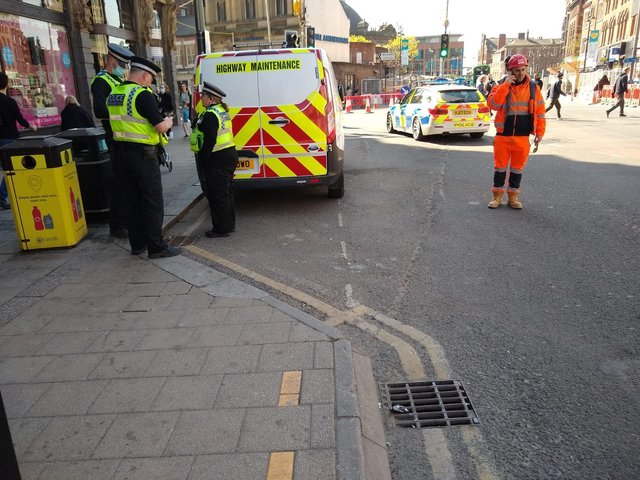 Police at the scene of an incident which closed Vicar Lane on Monday morning.