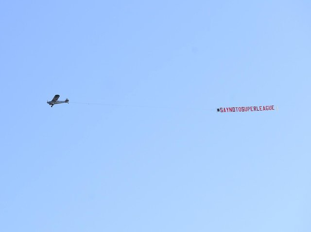 Leeds United fans fly a banner over Elland Road opposing the European Super League. Pic: Simon Hulme
