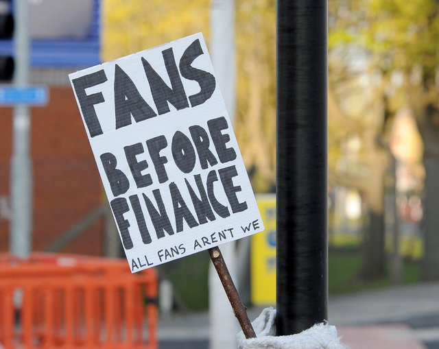 Fans gathered to protest against the European Super League outside Elland Road last night. Picture by Simon Hulme