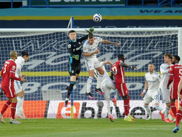 PRESSURE: Leeds United's Illan Meslier and Kalvin Phillips rise high to clear another Liverpool attack. Picture by Simon Hulme.