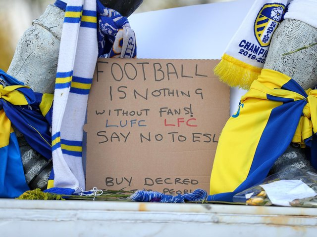 Signs left outside Leeds United's Elland Road stadium as football fans gathered to protest against European Super League plans.