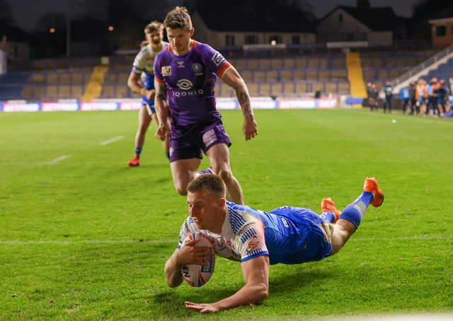 IN THE SPOTLIGHT: Leeds Rhinos' Alex Mellor touches down to scores against Wigan last week. Picture: Alex Whitehead/SWpix.com.