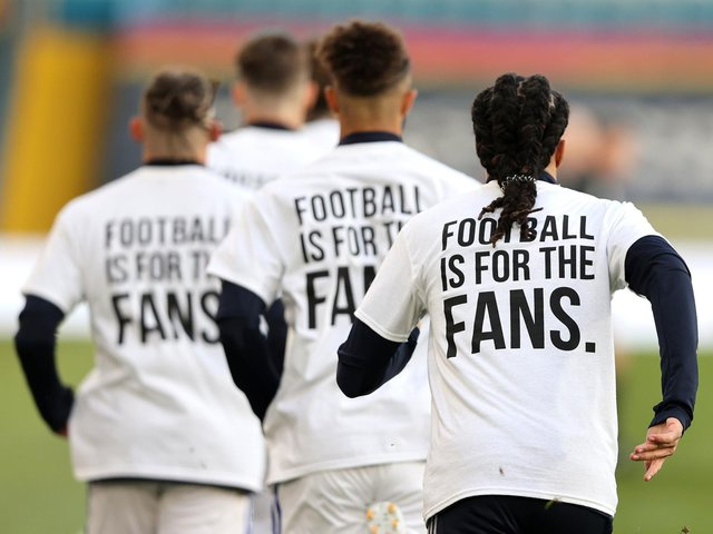 Leeds United players protested during the match against Liverpool at Elland Road on Monday night. Picture: PA.