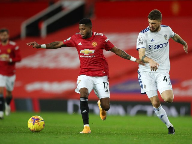 PRAISE: For Leeds United from Manchester United's Brazilian midfielder Fred, centre, pictured holding off Mateusz Klich in December's clash at Old Trafford. Photo by Nick Potts - Pool/Getty Images.