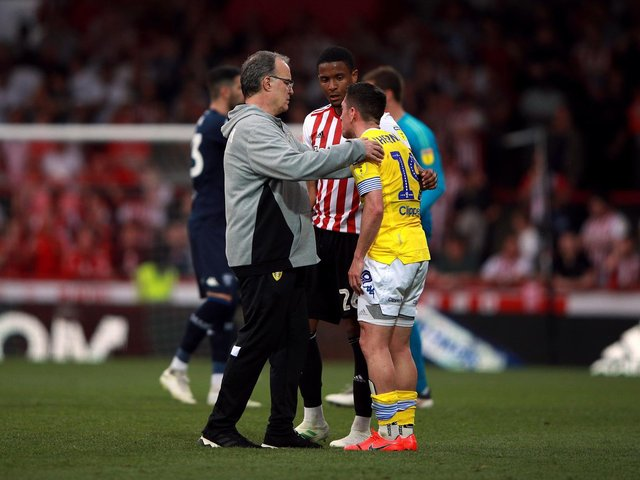DISTRUAGHT: Leeds United playmaker Pablo Hernandez, right, is consoled by Whites head coach Marcelo Bielsa, left, after the 2-0 defeat at Brentford of Monday, April 22, 2019. Picture by Ian Walton/PA Wire.