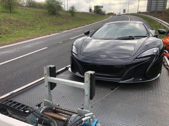 The McLaren being towed away (photo: WYP).