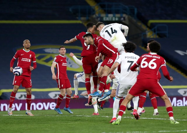 ON THE RISE: Leeds United's Diego Llorente scores his side's equaliser against Liverpool. Picture: Lee Smith/PA Wire.