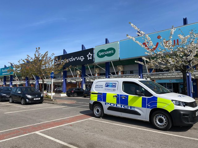 Police outside the Superdrug at Crown Point.
