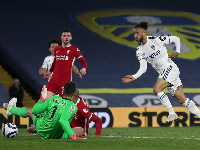 BIG STOP - Tyler Roberts, right, produced a fine save from Alisson Becker, when found by Ian Poveda, background. Pic: Getty