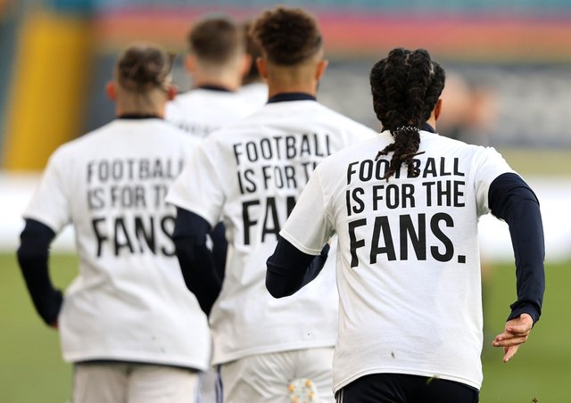 Leeds United players wear 'Football Is For The Fans' shirts during the warm up prior to the Premier League match against Liverpool. Picture: Clive Brunskill/PA Wire.