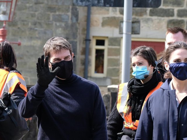Tom Cruise waves to onlookers as he films the latest Mission Impossible film in Yorkshire.