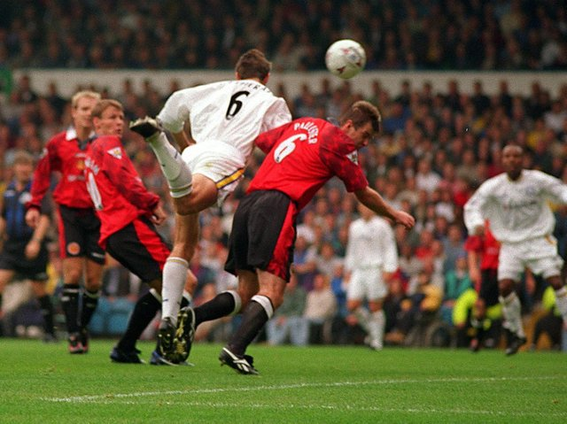 BIG GOAL - David Wetherall getting in front of Gary Pallister to score Leeds United's winner against Manchester United at Elland Road. Pic: Dan Oxtoby