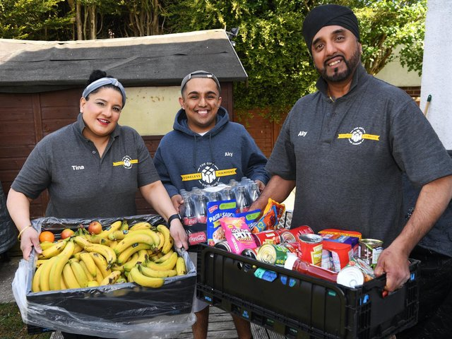 Aky and Tina Suryavansi  - who run  charity Homeless Hampers - pictured with son Akash  and donated food for homeless people.  Picture: Jonathan Gawthorpe