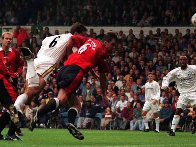 HEADING UP: David Wetherall beats Gary Pallister to the ball to net the only goal of the game in Leeds United's 1-0 victory at home to Manchester United of September 1997. Picture by Varleys.