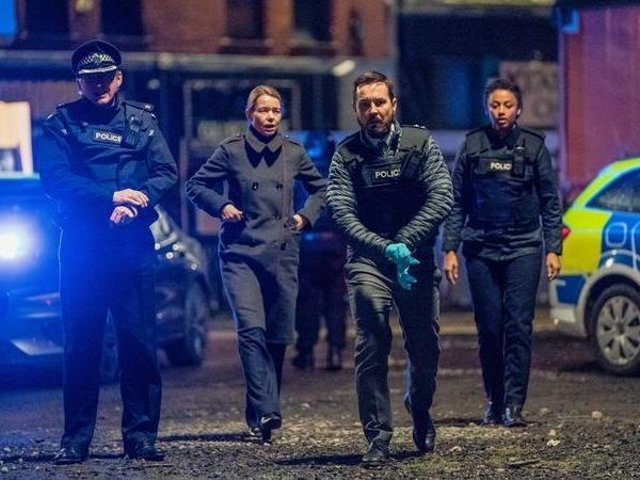 Martin Compston as Steve Arnott leads the charge at the scene of the Fleming-Pilkington shootout. PIC: BBC/World Productions/Steffan Hill