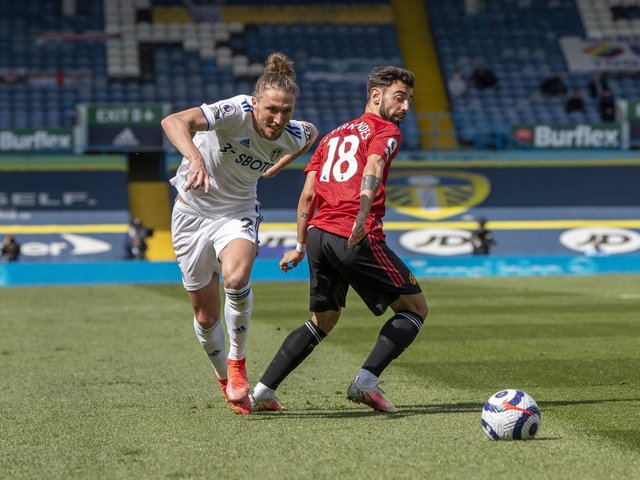 ALL SQUARE: Leeds United's Luke Ayling battles with Manchester United's Bruno Fernandes. Picture by Tony Johnson.